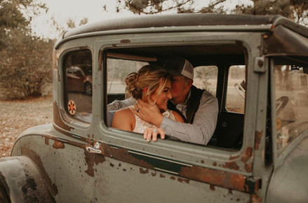 Bride and Groom Inside Old Car.jpg