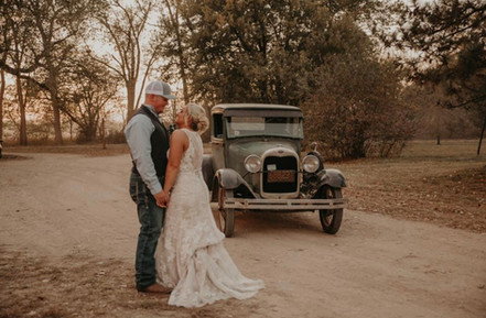 Bride and Groom in front of old car.jpg