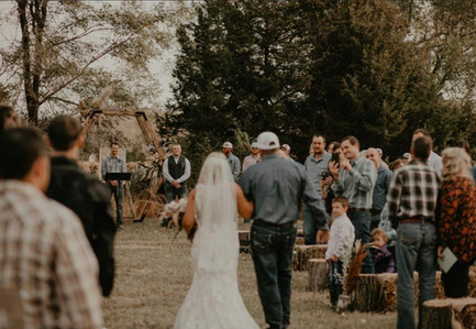 Bride and Dad from Behind.jpg