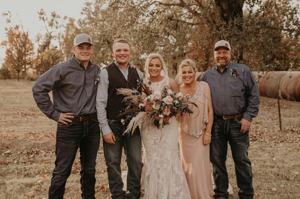 Bride and Groom with Family.jpg