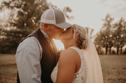 Bride and Groom Kiss at Sunset.jpg