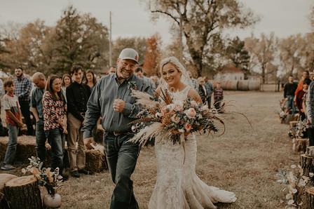 Bride and Dad walking down aisle.jpg