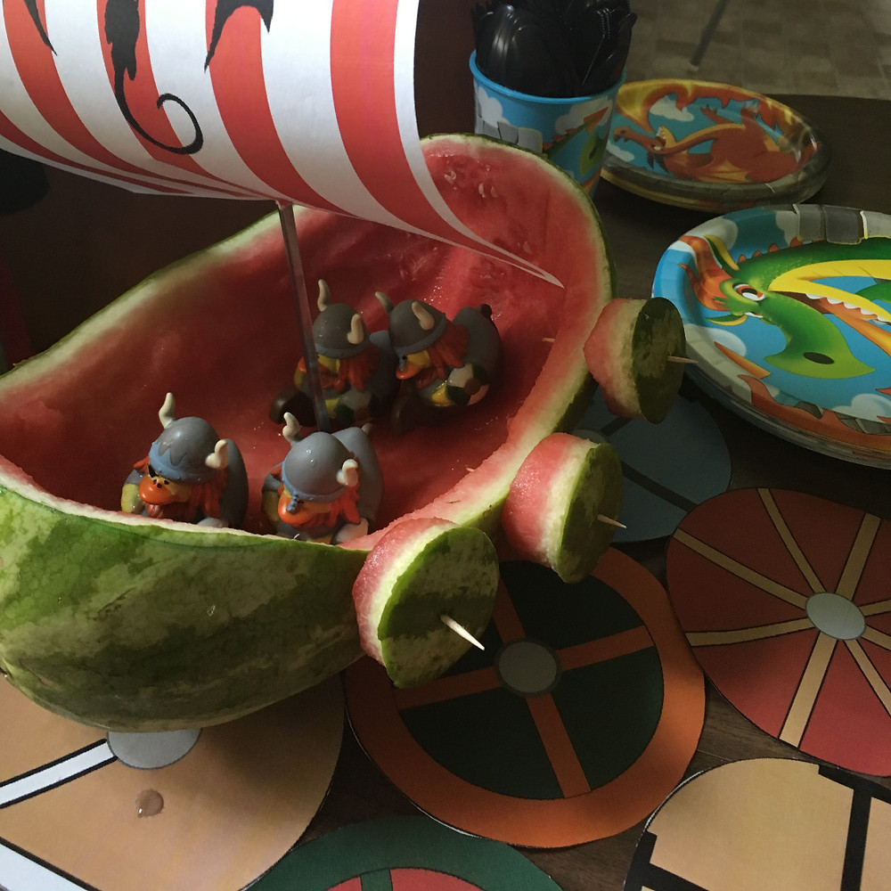 carved watermelon viking ship with viking rubber duckies