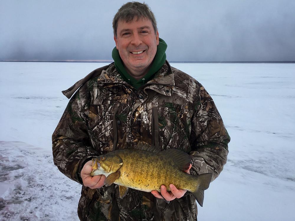 a very nice smallmouth bass caught ice fishing on Oneida Lake