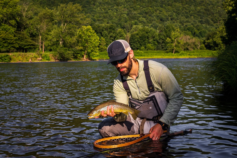 My Brother with a nice caddis eating west branch of the delaware river brown trout