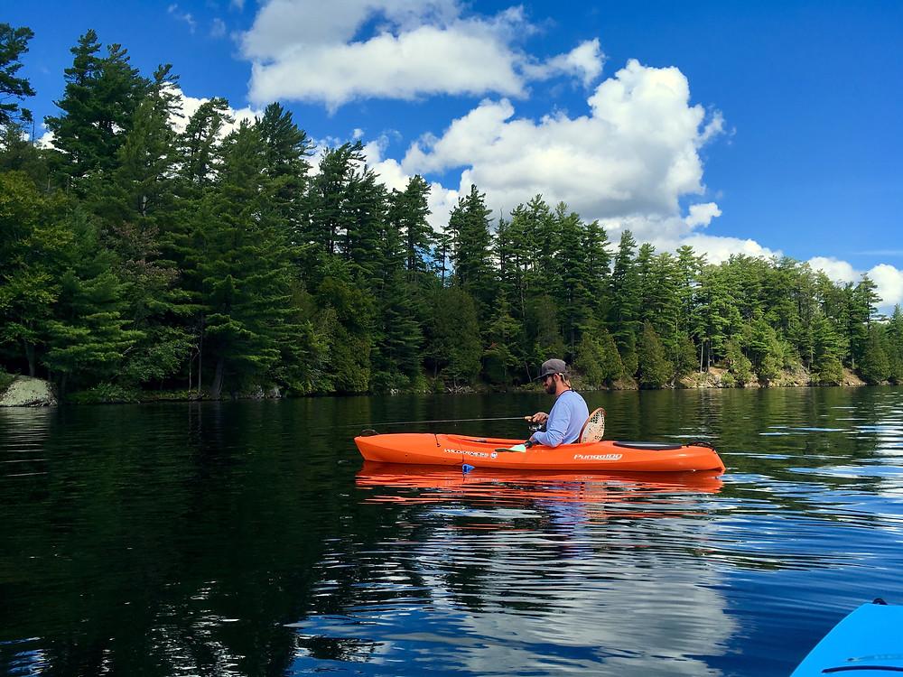 Brian Lansing is fishing and jigging for Adirondack lake trout.