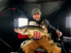 Oneida Lake ice fishing guide, Brian Lansing, with a nice walleye caught jigging.
