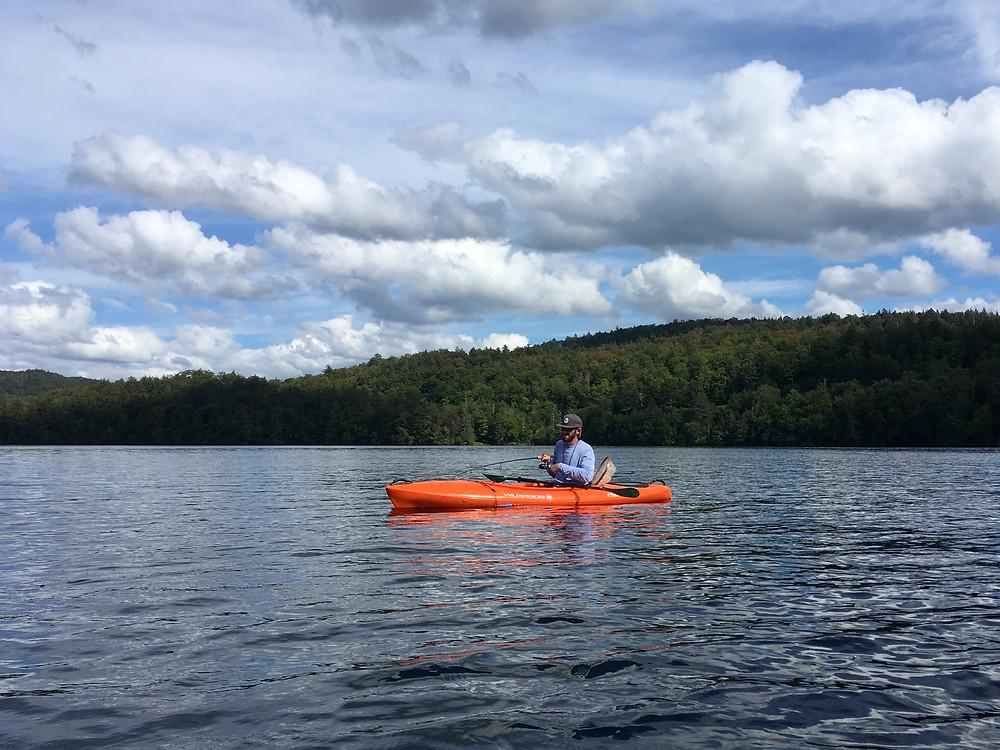 Brian Lansing is fishing for Adirondack lake trout.