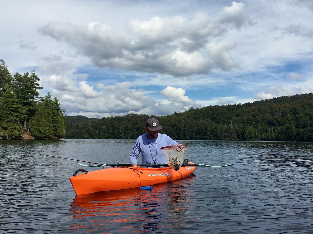 Upstate New York fishing guide, Brian Lansing, is holding a nice Adirondack lake trout.