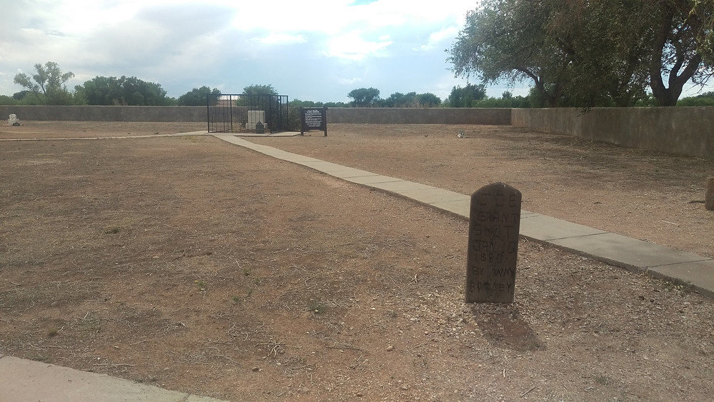 Grave of Billy the Kid in the background