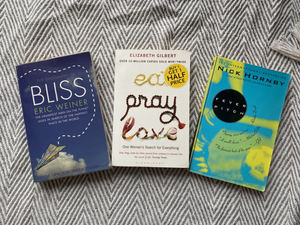 Best travel books to discover more than one country; Geogra[hy of bliss and Eat, Pray, Love