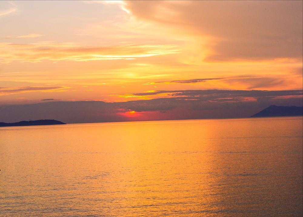 sunset in Logas beach - 7th heaven bar