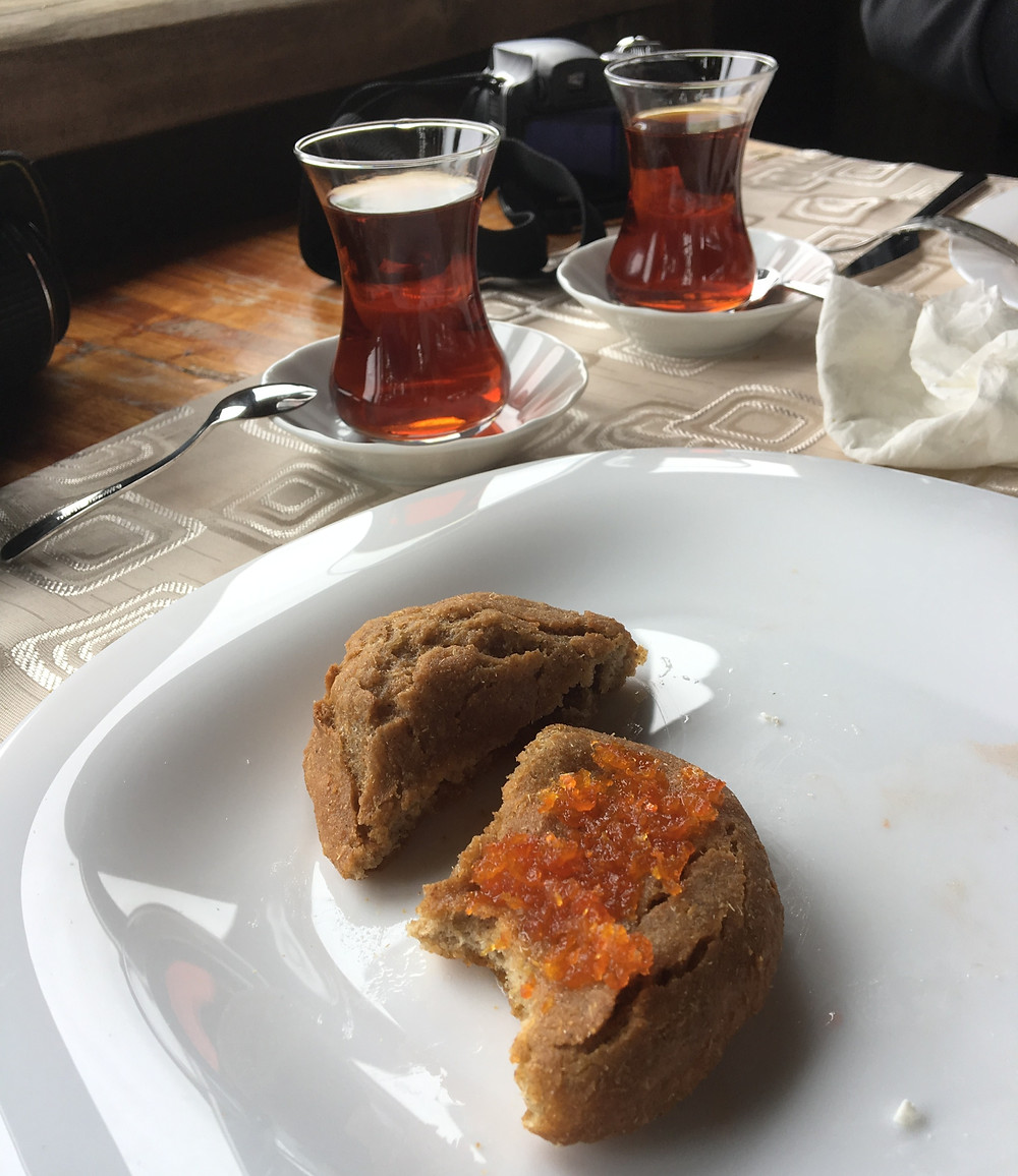 Turkish tea served in traditional glass and Turkish bread with jam