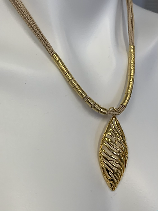Natura 18k pendant and natural fiber