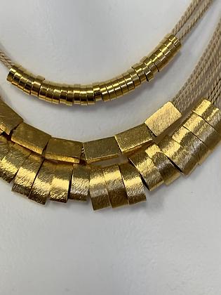 Natura 18Kt triple strand necklace