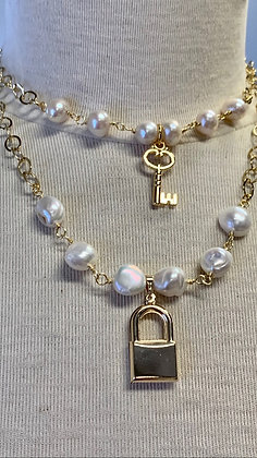 Pearls, chain and key