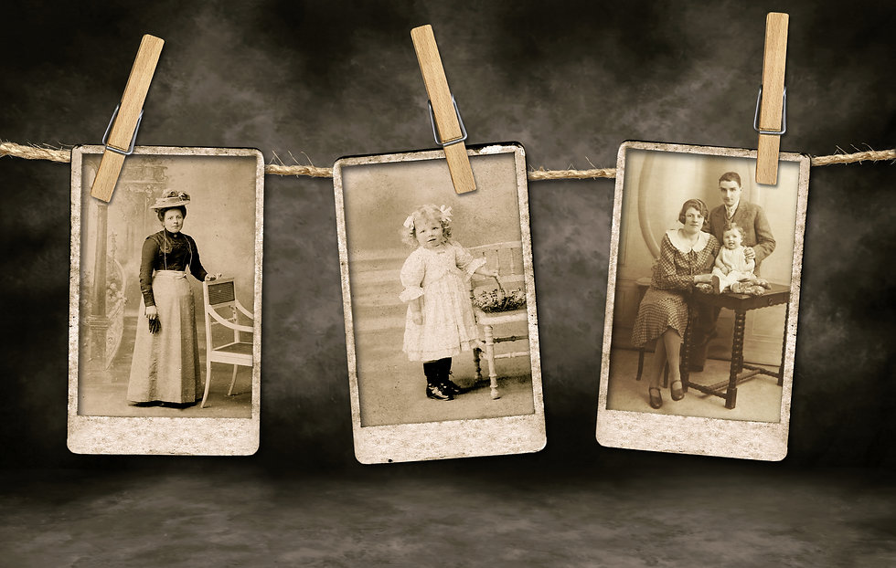 Three Authentic Vintage Family Photographs Hanging on a Rope By Clothespins.jpg