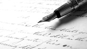 Fountain pen on an antique handwritten l
