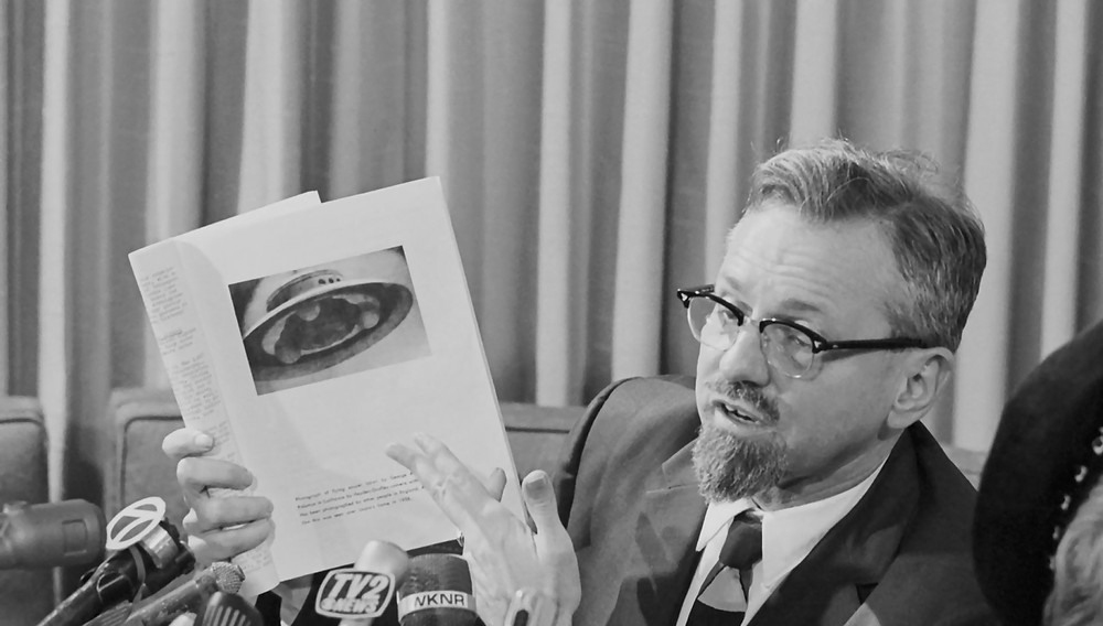 Dr. J. Allen Hynek, telling newsmen at a press conference that the photograph he is holding, widely circulated in the news media of a UFO spotted in Michigan