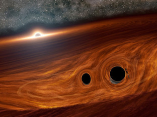 Colliding black holes may have created a surprising flare of light