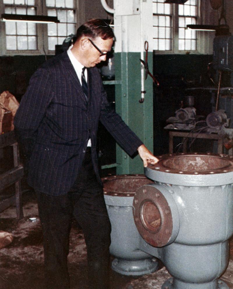 Owen Stiegelmeier standing next to one of the first repair jobs