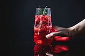 Stock image, person holding a cocktail