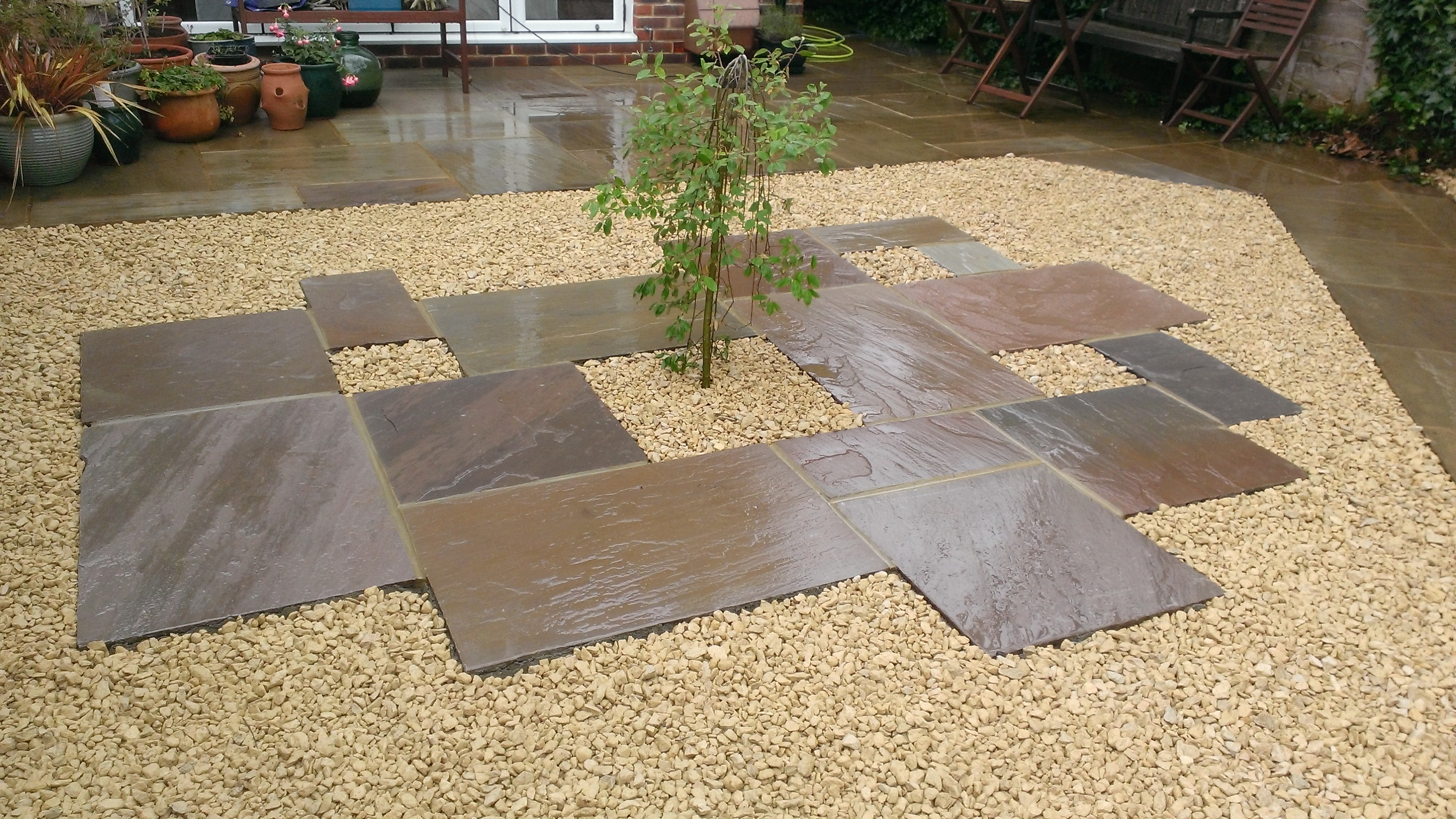Staggered sandstone paving