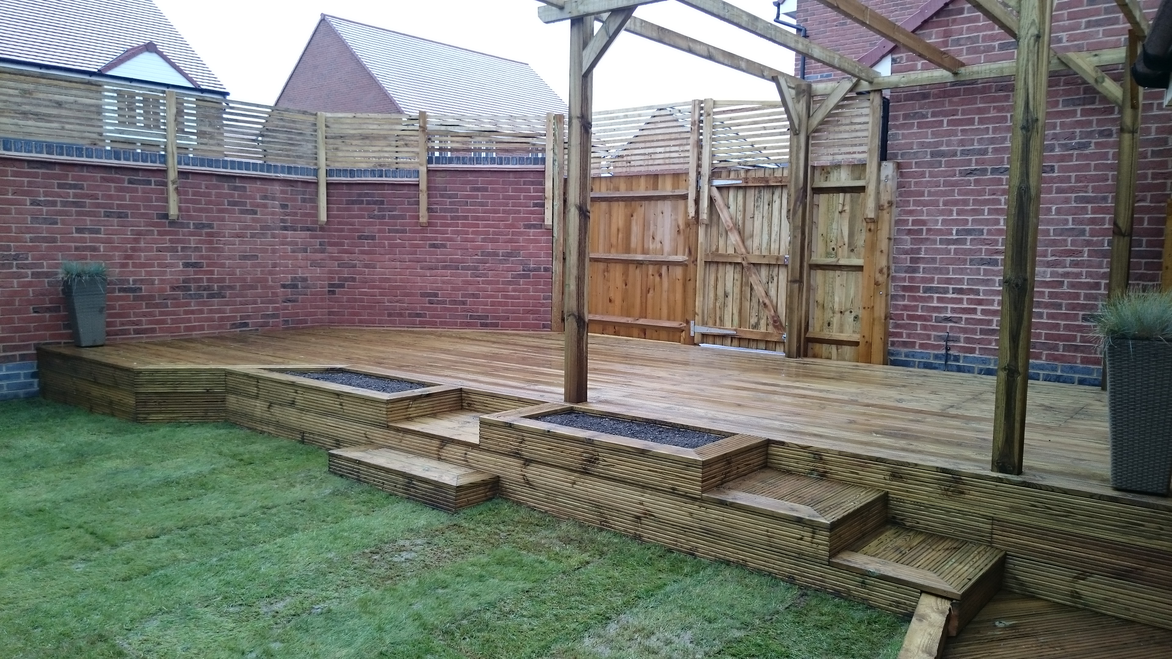 Raised softwood deck with planters