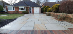 Sandstone driveway with brick edging