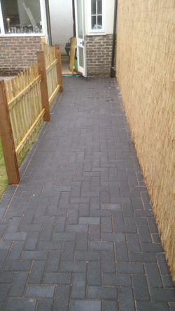 Charcoal block paving path