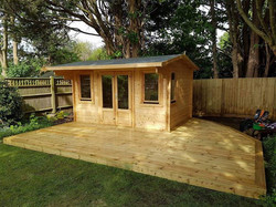 Decking around log cabin