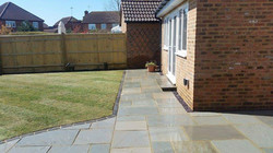 Block edged sandstone patio