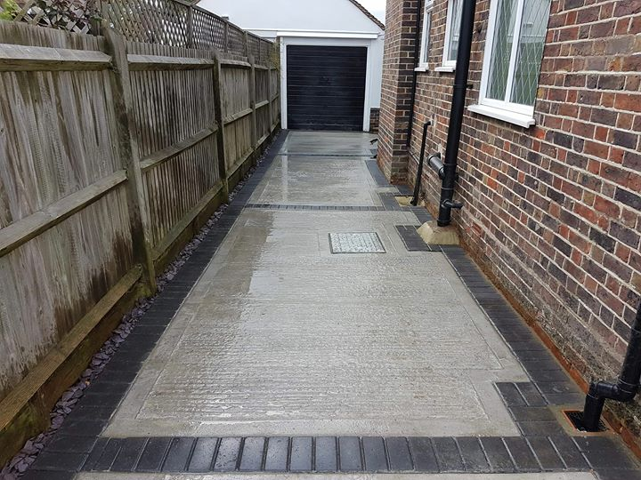 Concrete drive with paver edge