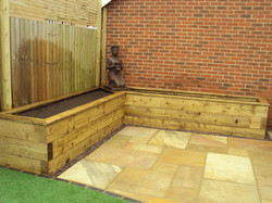 Deck capped sleeper planter