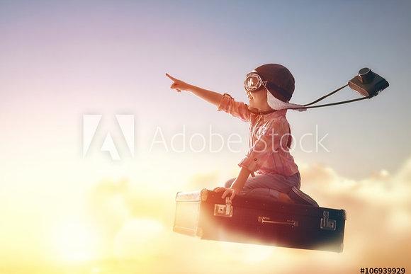 Jongetje op vliegend koffer