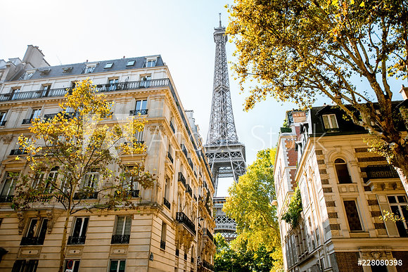 Beautiful street view with old residential buildings and Eiffel tower during th