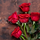 Thumbnail: 5 rode rozen op houten tafel