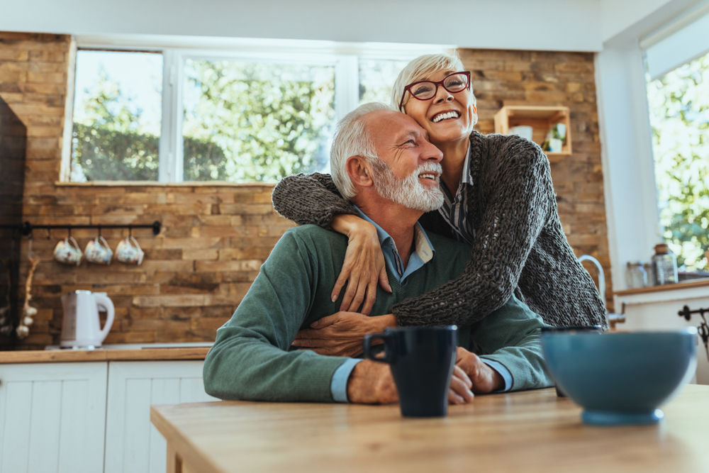 Older couple smiling and hugging | Dentures Manassas VA