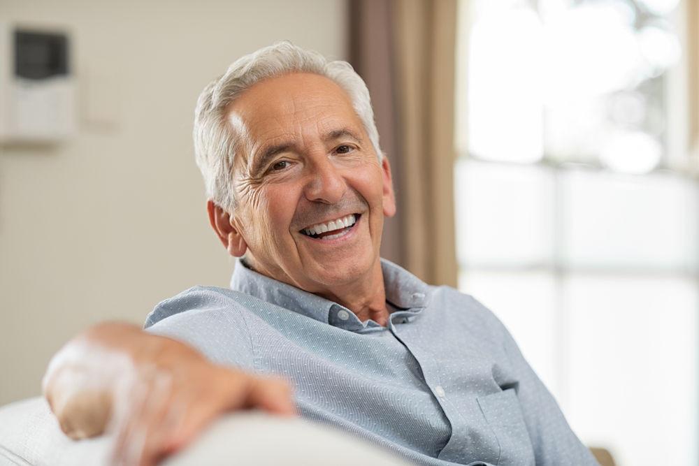 older man smiling | Dental Veneers Manassas VA