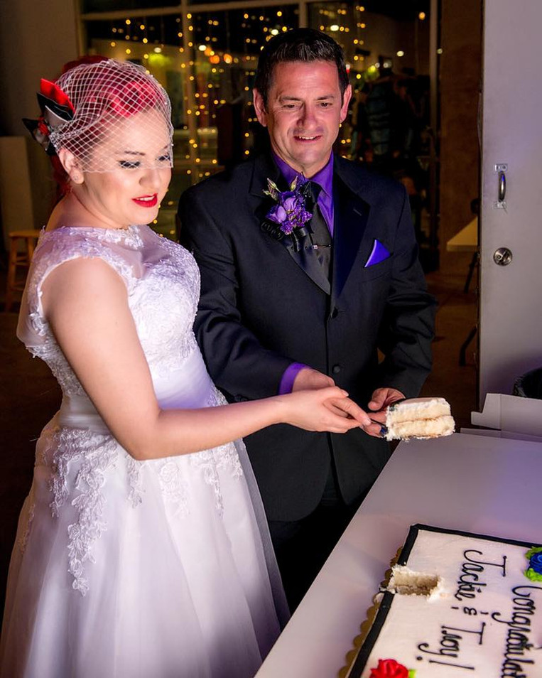 Hawkeye and Black Widow cutting the wedding cake