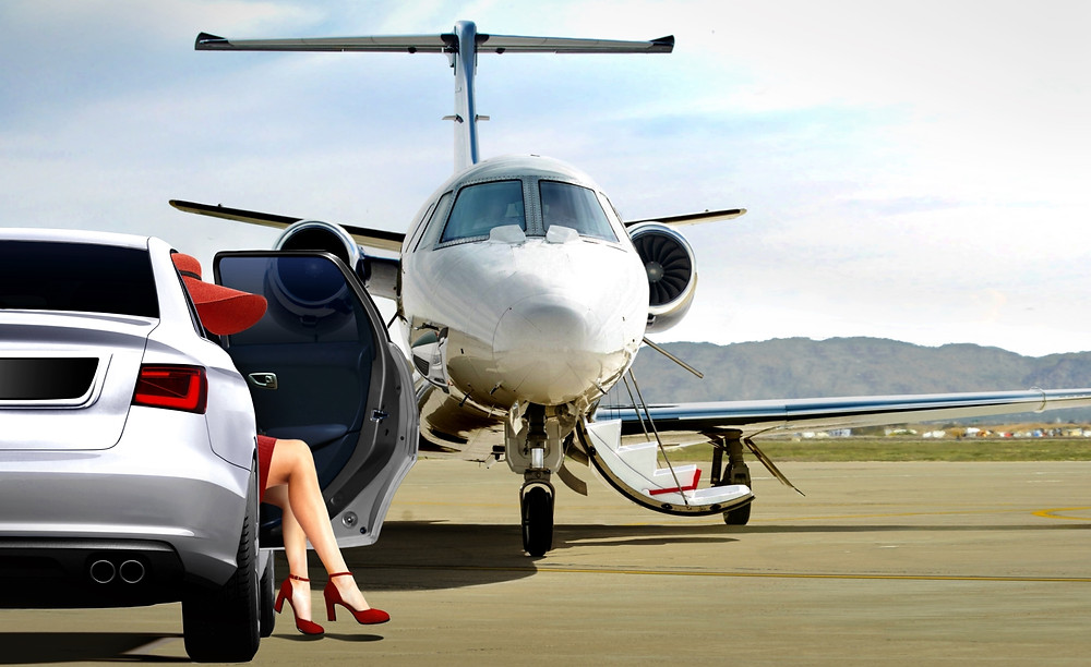 Women in red boarding business jet