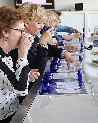 women tasting evoo