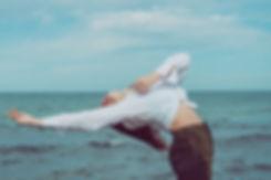 woman-leaning-backward-near-body-of-wate