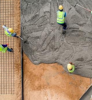 construction-worker-pouring-wet-concret-