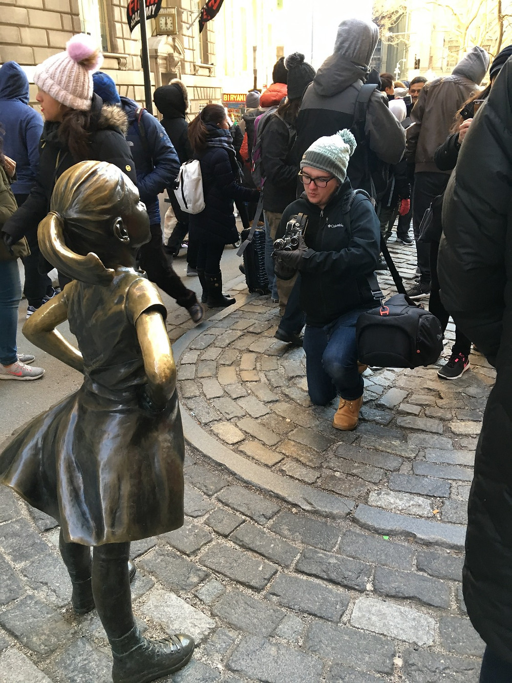 Blake Larson frames up a 16mm shot on Wall Street in New York