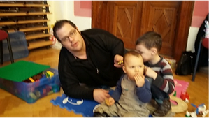 Father and sons in the play corner