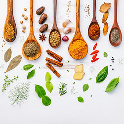 Various herbs and spices in wooden spoon
