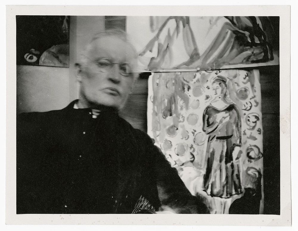 Edvard Munch, Self-Portrait Wearing Glasses and Seated Before Two Watercolors at Ekely, ca. 1930