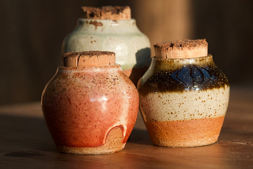 Small storage jar with a cork lid