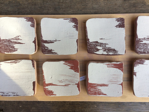 Layering slips with hakeme brush
